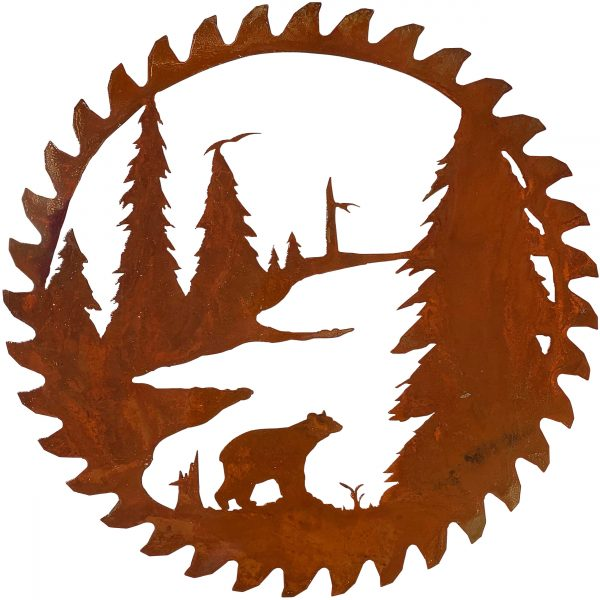 this modern replica of an antique buzz saw blade shows the close up detail of the bear standing among the pine trees and near a river