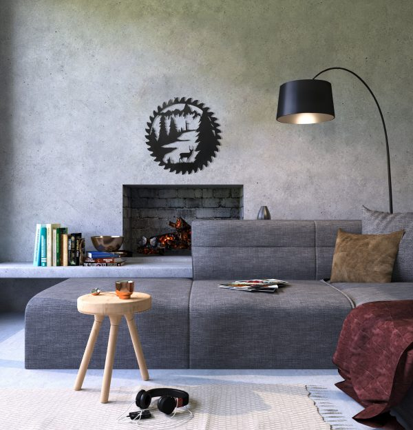 This scene of a deer standing among dead and living pine trees with a background of mountains and a stream has a finish of hammered black which gives great style to this modern living room space with neutral grey tones